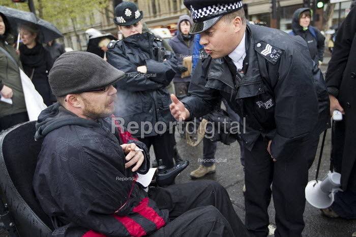 Disabled activists demonstrate and block the road at Trafalgar Square against benefit cuts and the Welfare Reform Bill. London. - Jess Hurd - 2012-04-18