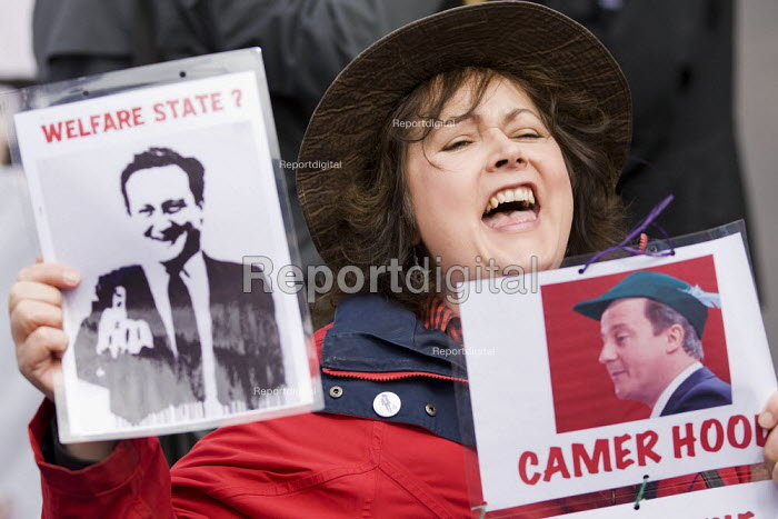 David Cameron as Camer Hood. Disabled activists demonstrate and block Trafalgar Square against benefit cuts and the Welfare Reform Bill. London. - Jess Hurd - 2012-04-18