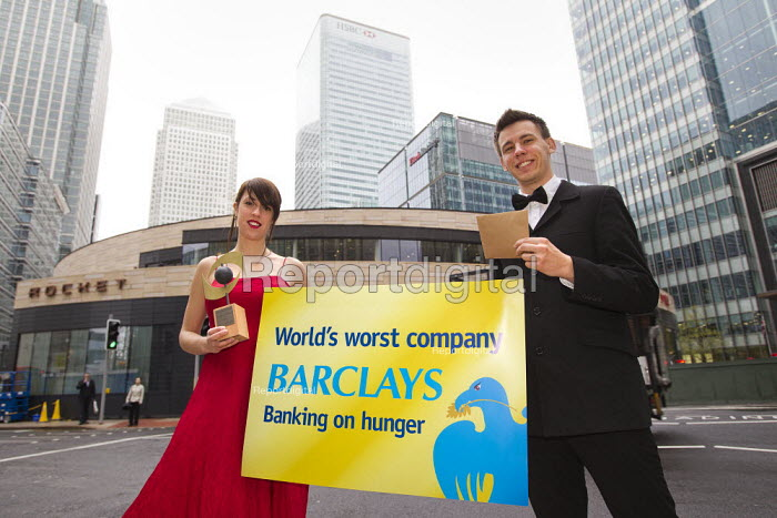 World Development Movement campaigners stage an award ceremony outside Barclays Bank HQ in Canary Wharf handing over a �shame award � won by the bank ahead of its AGM on 27 April. Two glamorous hosts in evening wear present the award after Barclays � CEO Bob Diamond failed to turn up to collect the prize in Davos, Switzerland, in January. The bank won a Public Eye �world worst company � award for speculating on food prices and fuelling hunger and poverty worldwide. London. - Jess Hurd - 2012-04-26