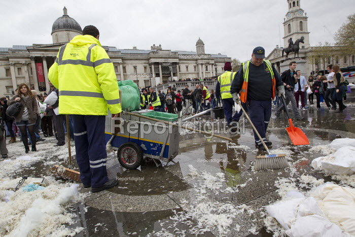 Heritage Wardens and Westminster City Council workers clean up after a Flash mob pillow fight in Trafalgar Square. International Pillow Fight Day, London. - Jess Hurd - 2012-04-07