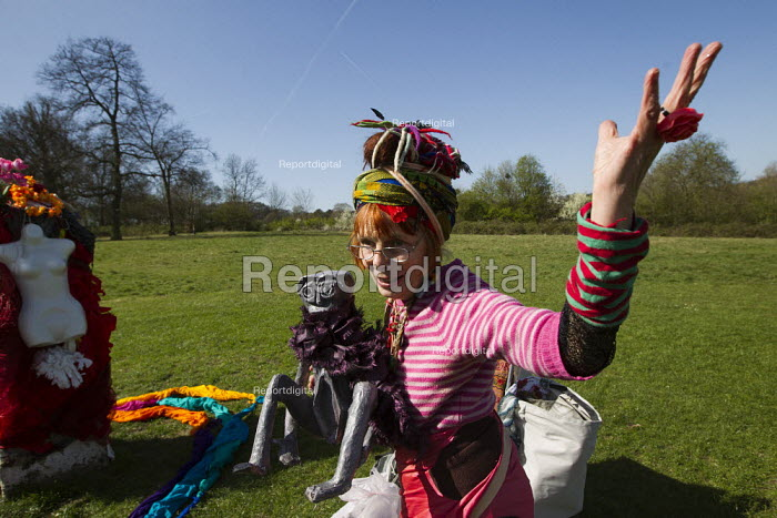 Raga Woods, peace activist and spiritualist leads an impromptu fertility ceremony, the Cunny Carnival with Sheela Na Gig The Stone of Free Speech, Hampstead Heath. London. The first Sunday of Women's Week. - Jess Hurd - 2012-04-01