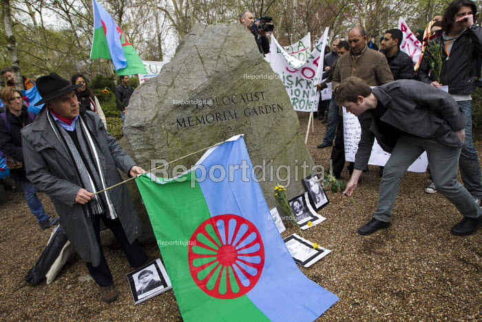 Campaigner and founder of the Gypsy Council, Grattan Puxon speaking at the Holocaust Memorial Stone on the oppression of Roma and on the genocide by the Nazis who murdered 500,000 Roma. Dale Farm and Roma supporters march to the Holocaust Memorial Garden on Romani Nation Day. Hyde Park, London. - Jess Hurd - 2012-04-08
