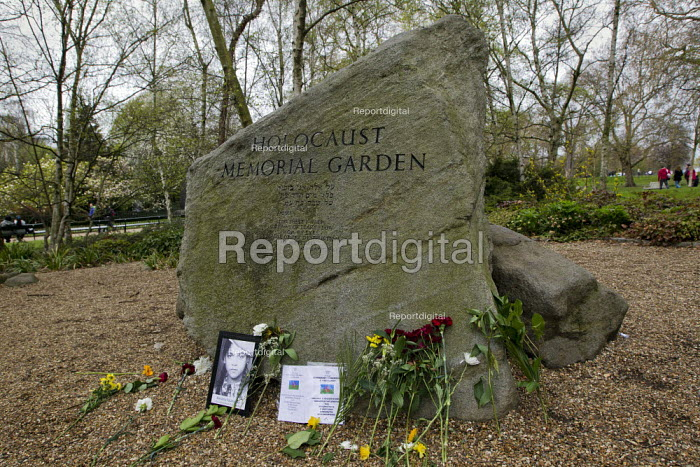 Pictues and flowers left at the Holocaust Memorial Stone in memory of the 500,000 Roma murdered by the Nazis. Dale Farm and Roma supporters march to the Holocaust Memorial Garden on Romani Nation Day. Hyde Park, London. - Jess Hurd - 2012-04-08