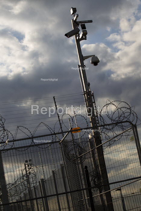 Security fence and CCTV around the Olympic stadium, Olympic Park, Stratford. East London. - Jess Hurd - 2012-04-16