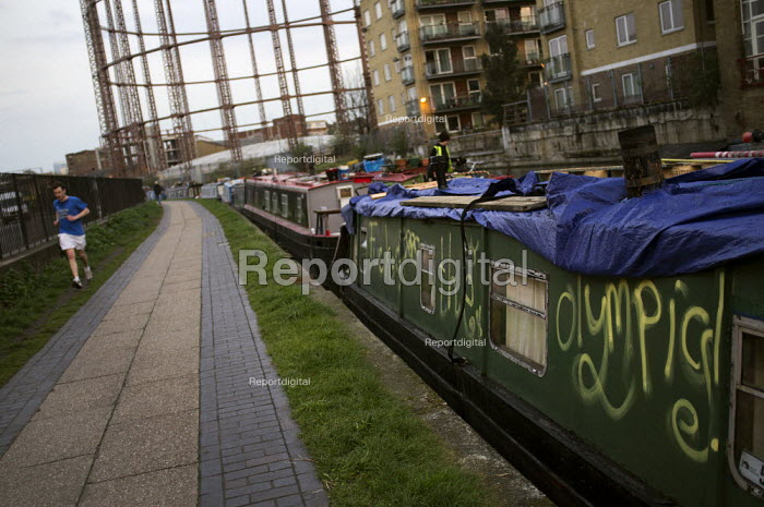 Canal barge on the the Regents Canal towpath, with Fuck The Olympics written on the side. Hackney Olypmic borough. London. - Jess Hurd - 2012-04-15