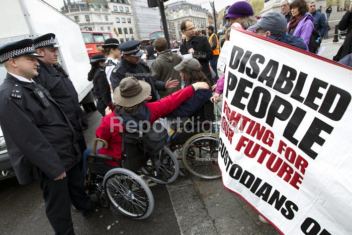 Disabled activists demonstrate and block Trafalgar Square against benefit cuts and the Welfare Reform Bill. London. - Jess Hurd - 2012-04-18
