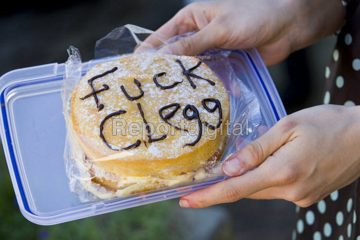 Fuck Clegg Victoria Sponge cake. UK Uncut Great London Street Party outside Nick Clegg MPs London home. Putney. - Jess Hurd - 2012-05-26
