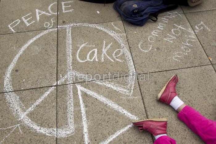 Peace of cake, Community not monarchy chalk drawn graphic on the pavement. UK Uncut anti austerity, anti monarchy street party, Diamond Jubilee weekend, Brighton. - Jess Hurd - 2012-06-02