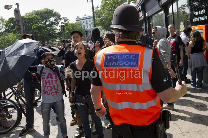 Police Liaison Officer drawing his baton as English Defence League disrupt a UK Uncut anti austerity, anti monarchy street party, Diamond Jubilee weekend, Brighton. - Jess Hurd - 2012-06-02