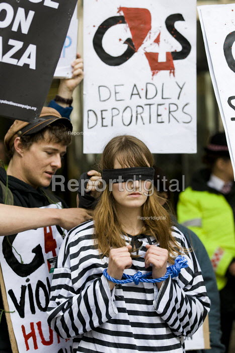 Protesters demonstrate outside the private security company G4S Annual General Meeting calling for an end to the firms involvement in human rights abuses around the world from Israeli prisons to UK immigration detention centres. London Stock Exchange, Paternoster Square, London - Jess Hurd - 2012-06-07