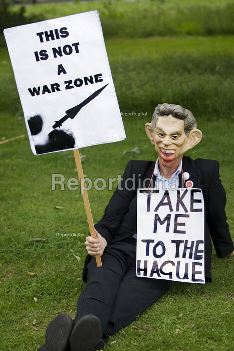 Protester with a Tony Blair mask demanding he be taken to The Hague for war crimes. March against MOD plans to site surface-to-air missiles on roofs for security during the Olympics, Bow, Tower Hamlets, East London. - Jess Hurd - 2012-06-30