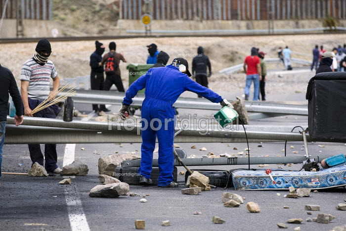Miners win running battles with police in Cinera after they have blocked the mountain road. The miners have been on strike since the government announced cuts to mining subsidies due to austerity cuts which will mean an end to mining. Leon, Northern Spain. - Jess Hurd - 2012-06-19
