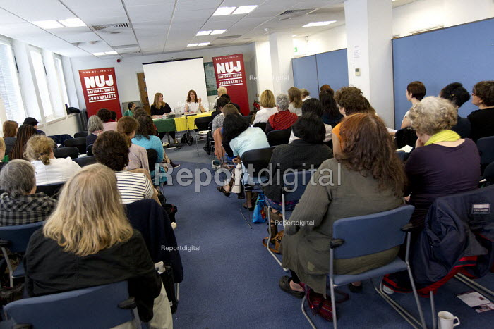 """NUJ Womens' Conference, Don't Tweet me this way """" the modern media """" still sexist and not just on paper. Scarlett Harris, the TUC Womens Equality Officer (speaking) with Michelle Stanistreet NUJ Gen Sec, and Bidisha, Guardian columnist and broadcaster. Headland House, London. - Jess Hurd - 2012-07-04"""