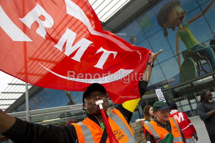 London Underground cleaners walk out as 2012 Olympic Games begin in a dispute with private contractors ISS and Initial over pay and travel passes. Stratford Station, Newham. London. - Jess Hurd - 2012-07-27
