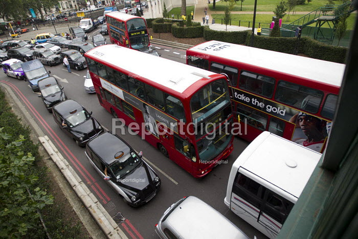 Black cab taxi drivers protest against the Olympic Lane restrictions or Zil Lanes, the protest resulted in gridlock at Hyde Park Corner, London. - Jess Hurd - 2012-07-27
