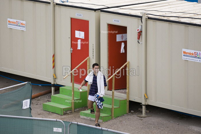Showers and bathroom facilities. Cleaners 18.00 per night portacabin accommodation during the London 2012 Olympics, Camp Cleanevent (Spotless International Services), Newham. London. - Jess Hurd - 2012-08-02