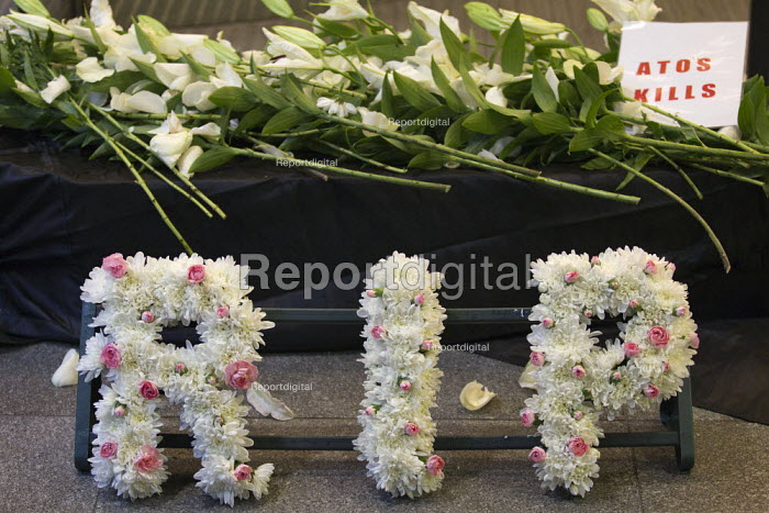 Disabled protesters lay a coffin outside Atos HQ to represent the people who have committed suicide after having their benefits cut. RIP. Opening day of the Paralympics. Euston, London. - Jess Hurd - 2012-08-29