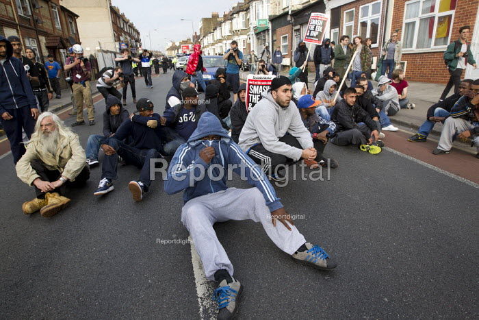 Local people sit down in the road, are stopped from protesting against the EDL. A march and rally by the English Defence League is stopped by thousands of local anti-fascist protesters We Are Waltham Forest, who blocked the march by sitting in the road. Walthamstow. - Jess Hurd - 2012-09-01