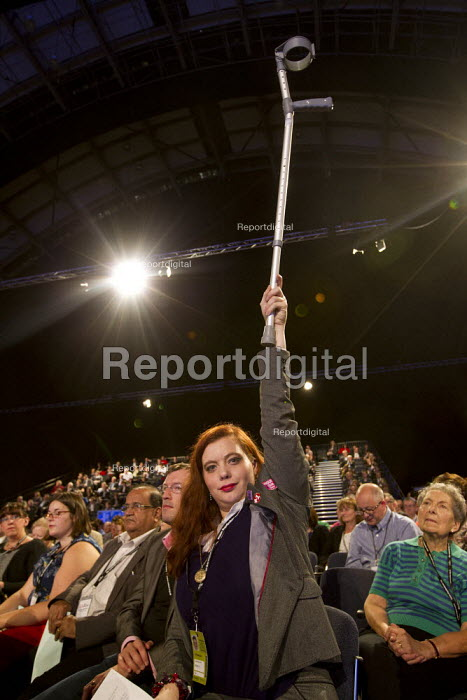 A delegate trying to speak in a debate using a crutch. Labour Party Conference 2012, Manchester. - Jess Hurd - 2012-10-01