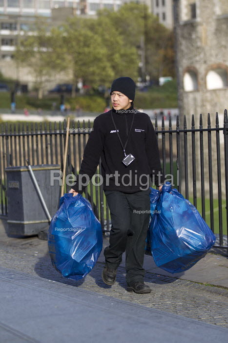 Mitie contract cleaner emptying rubbish bins, Tower of London, Historic London Palaces. - Jess Hurd - 2012-11-03