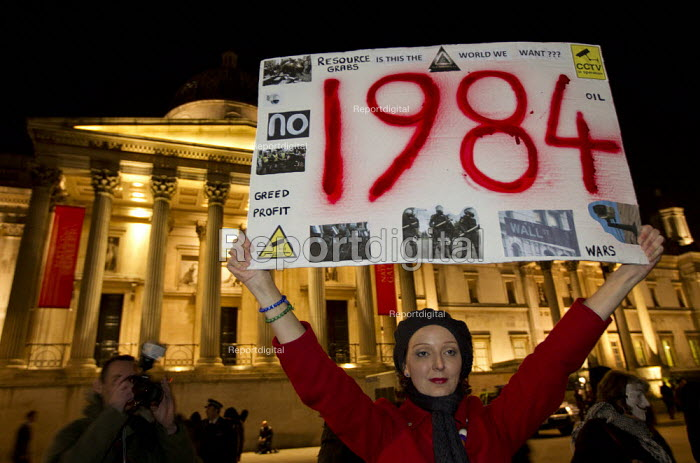 1984 placard London joins a worldwide day of protests and cyber attacks against governments, banks and security firms has been launched by Hacker collective Anonymous to mark Guy Fawkes Day. March from Trafalgar Square to Westminster Parliament. - Jess Hurd - 2012-11-05