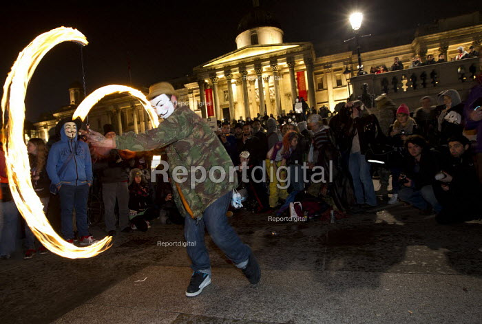 Glow poi or fire poi as London joins a worldwide day of protests and cyber attacks against governments, banks and security firms has been launched by Hacker collective Anonymous to mark Guy Fawkes Day. March from Trafalgar Square to Westminster Parliament. - Jess Hurd - 2012-11-05