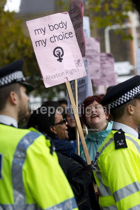 Anti-abortionists hold a prayer vigil outside the Stratford BPAS Clinic, with offers a range of sexual health services and some kinds of abortions. They are countered by a pro abortion protest, defending women's right to choose. Newham, East London. - Jess Hurd - 2012-11-10