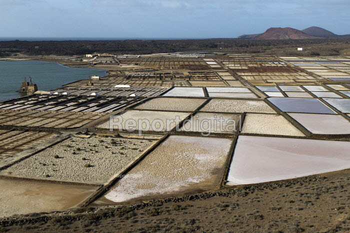 Salinas De Janubio 19th Century saltine, solar evaporation salt pans, Lanzarote, Canary Islands. The seawater or brine is fed into large ponds and water is drawn out through natural evaporation which allows the salt to be subsequently harvested. - Jess Hurd - 2013-01-14