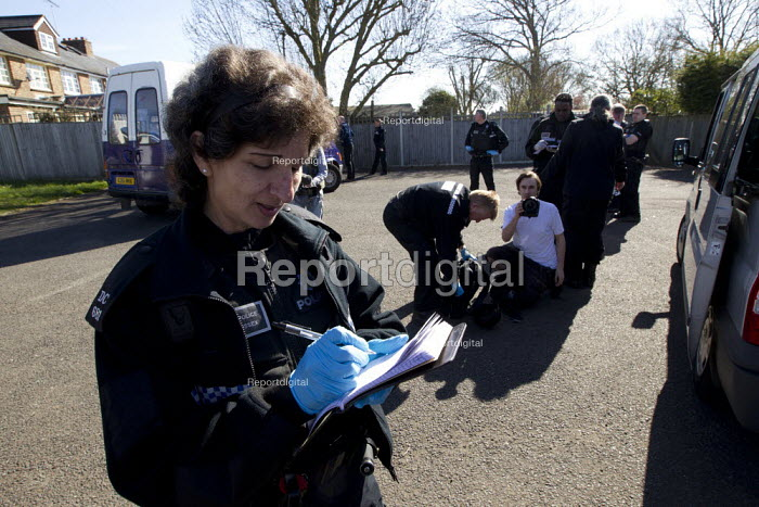 Press photographers get pulled off the motorway by traffic police and stop and searched for weapons under S60 and S60AA of the Public Order Act, quoted as the Terrorism Act. On route to the March for England, Brighton. - Jess Hurd - 2013-04-21