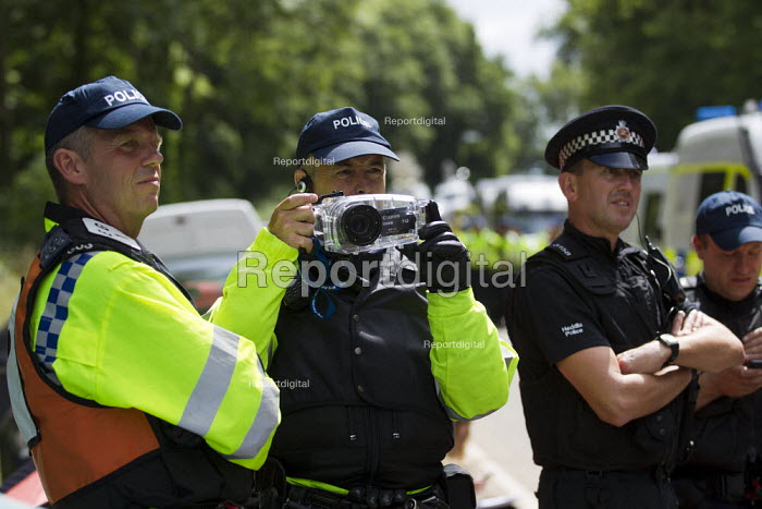 Police evidence gatherers. Anti Fracking campaigners join a civil disobedience day in Balcombe in a protest against energy company Cuadrilla Resources who are drilling in Balcombe, West Sussex. - Jess Hurd - 2013-08-19