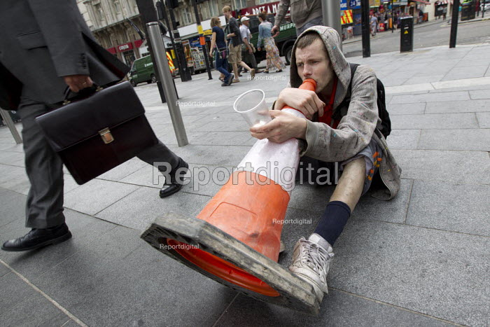 Man busking with a traffic cone, plays an interpretation of The Carpenters song - Close to you. Central London. - Jess Hurd - 2013-09-03