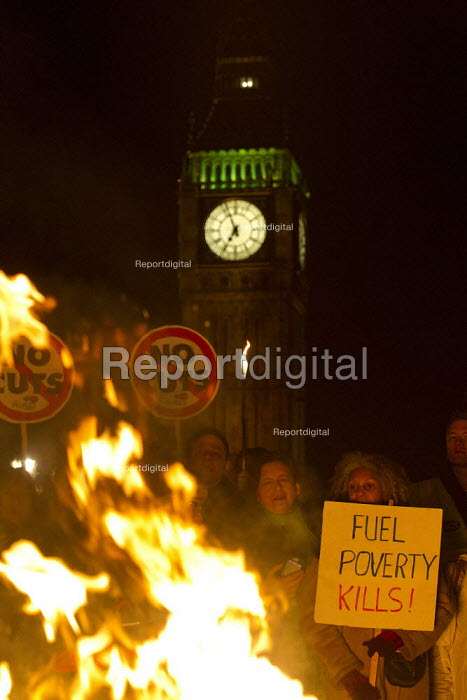 The Peoples' Assembly, Bonfire of Austerity burn fuel bills of Westminster Bridge outside Parliament to mark November 5th. London. - Jess Hurd - 2013-11-05