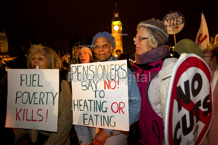 Pensioners say no to heating or eating. The Peoples' Assembly, Bonfire of Austerity burn fuel bills of Westminster Bridge outside Parliament to mark November 5th. London. - Jess Hurd - 2013-11-05