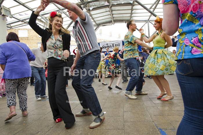 Carmen Ghia & The Hotrods play Swing EAST festival in Poplar. Built in 1951 as part of the Festival of Britain, Chrisp Street Market is in the heart East End of London. - Jess Hurd - 2014-06-29