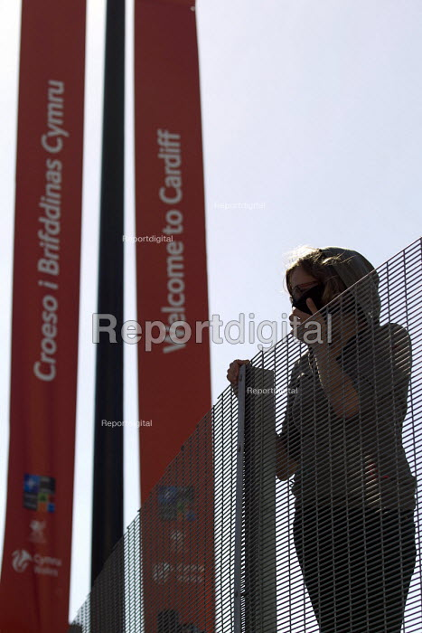 Peace protesters hang banners from the security fence at Cardiff Castle, a NATO Summit venue, Cardiff, South Wales. - Jess Hurd - 2014-08-31