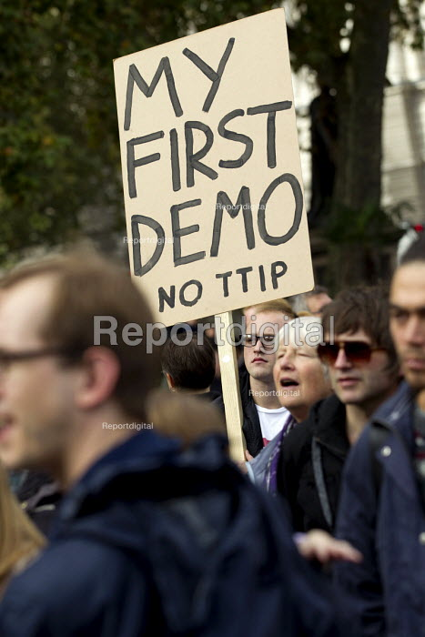 No TTIP, protest against the USA EU Transatlantic Trade and Investment Partnership, a trade deal currently being negotiated between America and the European Union. Parliament Square, Westminster, London. - Jess Hurd - 2014-10-11