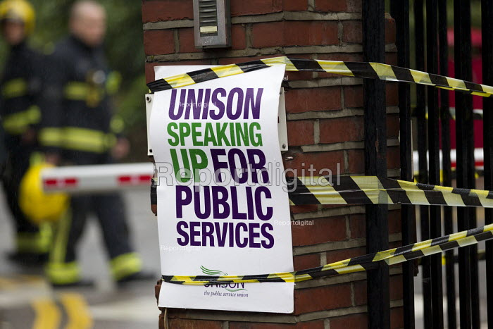 NHS public service workers strike in a dispute over pay. St Pancras Hospital, Kings Cross, London, Firefighters at work in the background - Jess Hurd - 2014-10-13