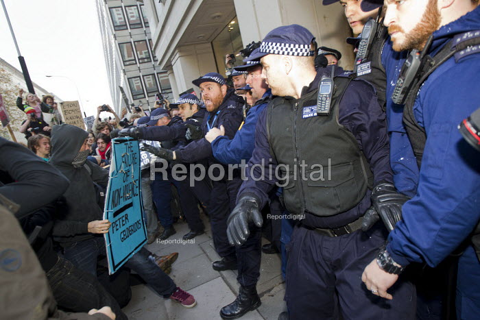 Peter Gelderloos author of The Failure of Non-violence placard. Police protect Starbucks coffee shop. Thousands of students march against debt and for free education. London. - Jess Hurd - 2014-11-19