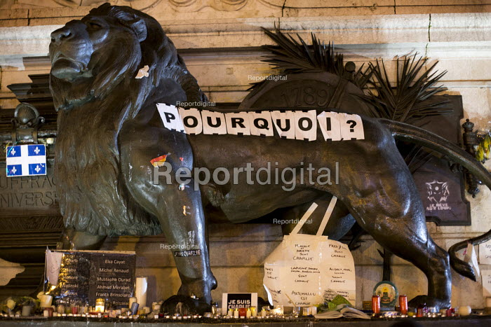 Pourquoi? - Why? Je suis Charlie Hebdo: A solidarity memorial in the Place de la Republique, after the shooting of cartoonists in the attack on the Charlie Hebdo magazine offices, Paris. - Jess Hurd - 2014-01-10