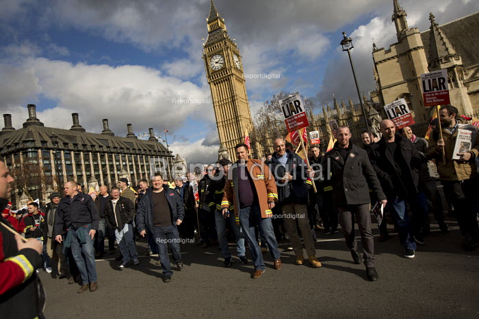 Striking firefighters rally and protest outside parliament in a long-running pensions dispute. Westminster. London. - Jess Hurd - 2015-02-25