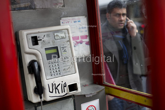 UKIP graffiti in public telephone boxes across North West London. - Jess Hurd - 2015-03-23
