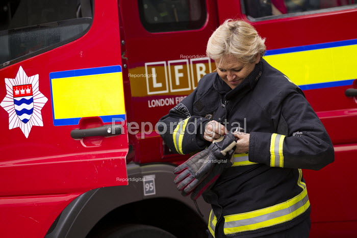 Sian Griffiths, White Watch Manager. Retiring after 30 years and one of the first LFB female firefighters. Paddington Fire Station. London. - Jess Hurd - 2015-03-17