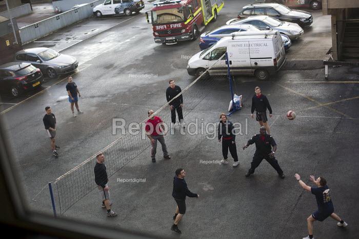 Firefighters playing beachball in the yard. Paddington Fire Station. London. - Jess Hurd - 2015-03-24