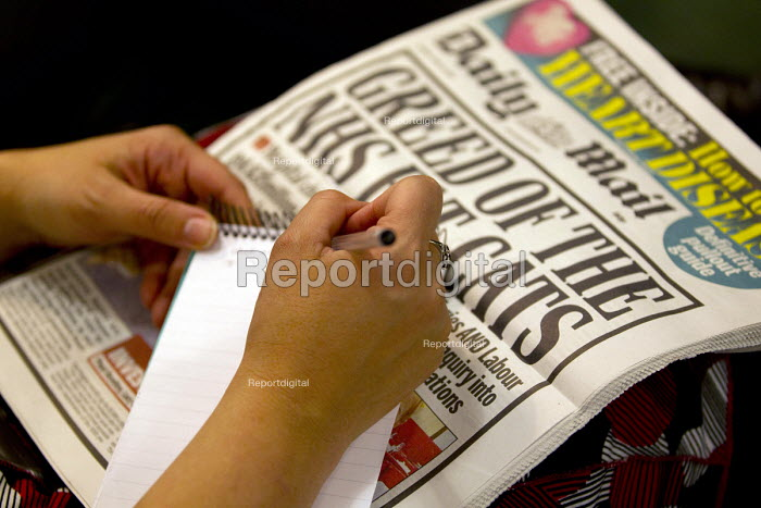 Reporter with notebook and a copy of the Daily Mail. Launch of NHS week, including new analysis of Tory plans, a poster launch and Q&A, London. - Jess Hurd - 2015-04-20