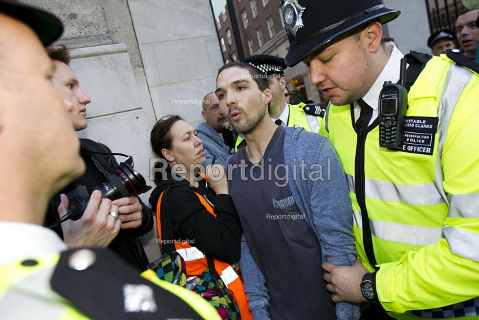 Protester is arrested for obstruction. Social housing and anti-gentrification campaigners disrupt the annual Property Awards attended by luxury property development companies. Grosvenor Hotel, Park Lane. London. - Jess Hurd - 2015-04-22