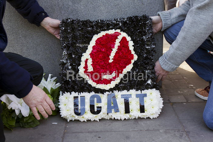 Laying a wreath from UCATT. International Workers Memorial Day rally beside the Building Worker statue, Tower Hill, London. - Jess Hurd - 2015-04-29