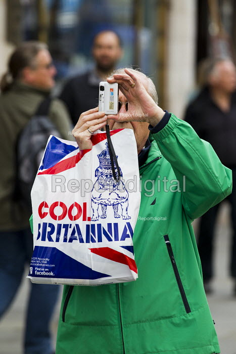 Cool Britannia, tourist photographs the May Day, International Workers Day protest. London. - Jess Hurd - 2015-05-01