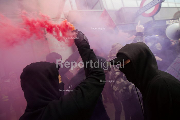 Class War protest against Poor Doors - different entrances for social housing and penthouse accommodation in Aldgate East. The protest marches through London to a squat party in Soho. May Day, International Workers Day protest. London. - Jess Hurd - 2015-05-01