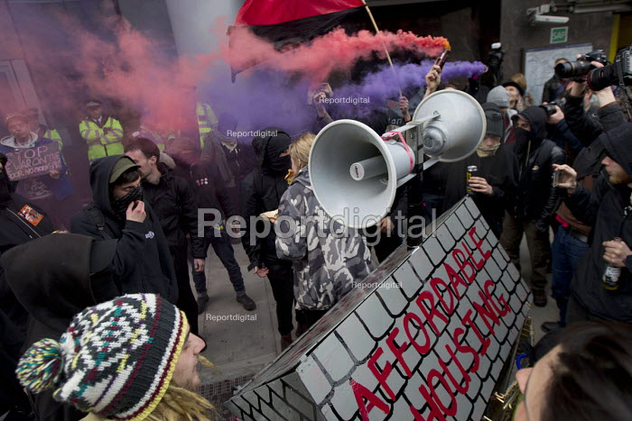 Class War protest against Poor Doors - different entrances for social housing and penthouse accommodationin Aldgate East. May Day, International Workers Day protest. London. - Jess Hurd - 2015-05-01