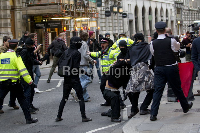 Class War clash with police. Class War protest against Poor Doors - different entrances for social housing and penthouse accommodation in Aldgate East. May Day, International Workers Day protest. London. - Jess Hurd - 2015-05-01